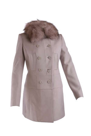 Beige winter coat with fur collar isolated on white photo