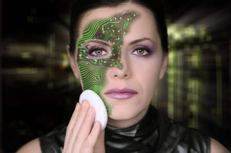 Cyber woman removing makeup from her face photo
