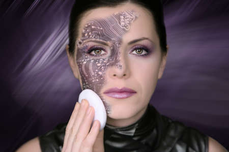 Cyber woman removing makeup from her face Stock Photo - 8094573