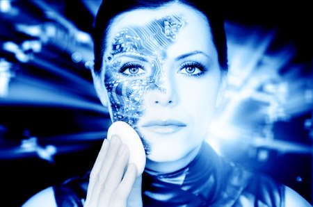 Bionic woman removing makeup from her face toned in blue photo