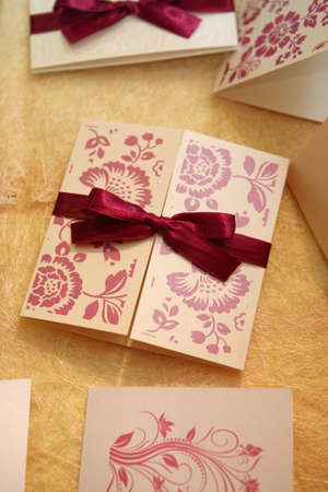 Wedding invitation with flower ornaments and silk ribbon