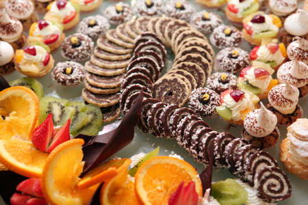 Diversity of pastry decorated with fruit photo