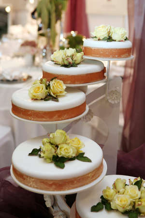 Beautiful wedding cake decorated with yellow roses