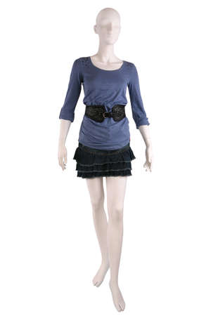 Mannequin dressed in shirt and skirt isolated on white photo