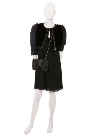 Mannequin dressed in jacket with fur and black dress photo