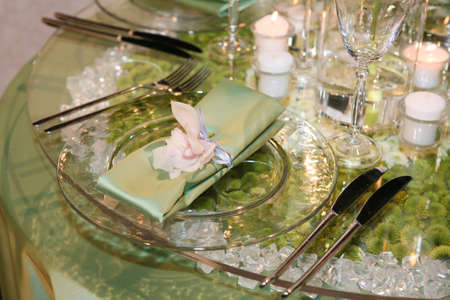 Elegant wedding dinner derved on a glass table