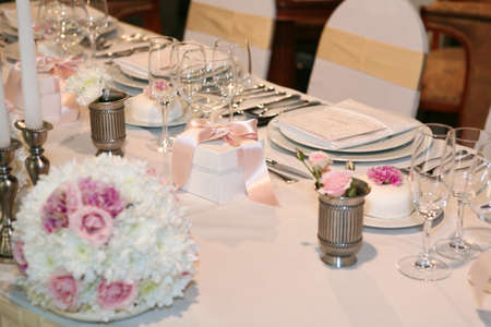 Elegant table setting for a wedding or dinner event  photo
