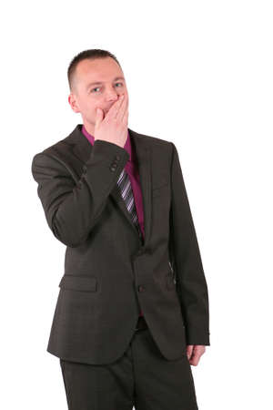 Young businessman covering his mouth with his hand, isolated ohn white photo