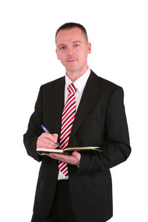 Young businessman in a suit holding a planner photo