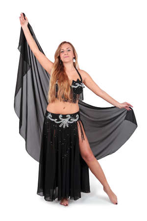 Beautiful belly dancer with long blond hair, isolated on white photo