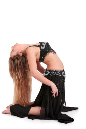 bend over: Blonde belly dancer bending on the floor, isolated on white Stock Photo