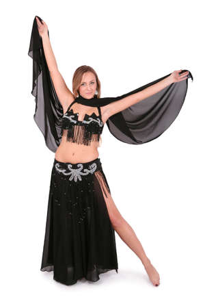 Beautiful belly dancer posing with a veil, isolated on white photo