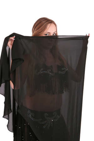 Belly dancer covers her face with a black veil photo
