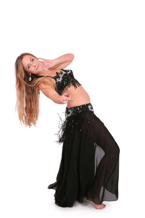 Beautiful belly dancer performing, isolated on white photo