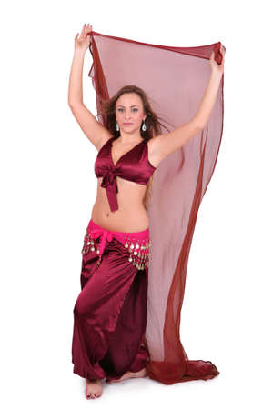 Beautiful belly dancer with red veil, isolated on white photo