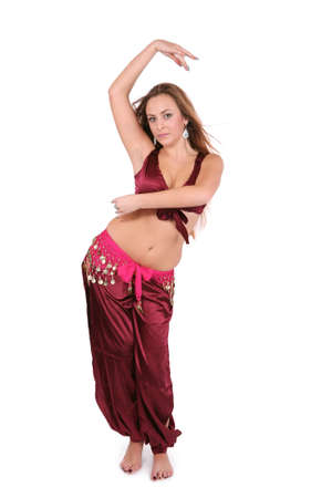 Beautiful young belly dancer in red costume, isolated on white photo