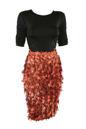 Black shirt and copper color skirt dressed on a mannequin, isolated on white photo