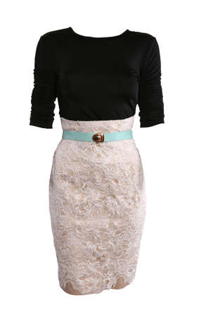 Black shirt and beige lace skirt dressed on a mannequin, isolated on white photo