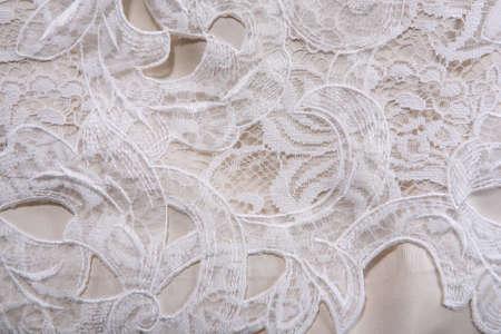 Beige fine lace on silk background photo