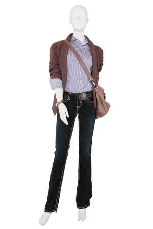 Mannequin dressed in female fashionable clothes, isolated on white photo