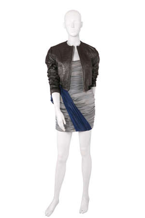 Mannequin dressed in cocktail dress and a jacket, isolated on white photo
