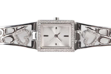 Female silver wrist watch with diamonds, isolated on white photo