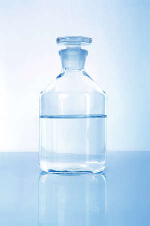 Medical alcohol container with liquid inside-half full and toned in blue Stock Photo - 9539919