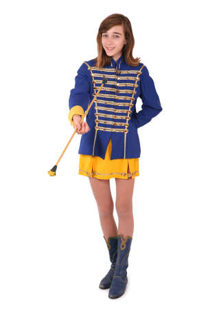 twirling: Teenage majorette in her uniform twirling a baton, isolated on white