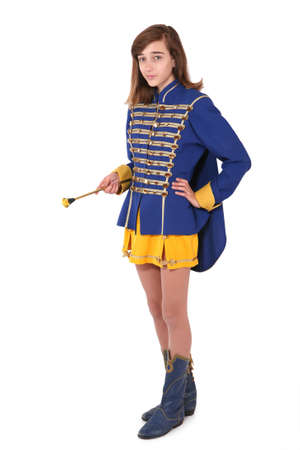 school uniform girl: Teenage majorette in her uniform and with baton, isoalted on white Stock Photo
