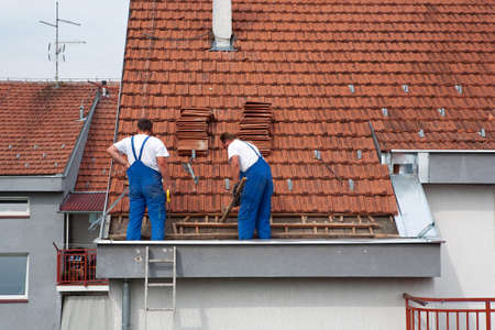Two men working on the roof photo