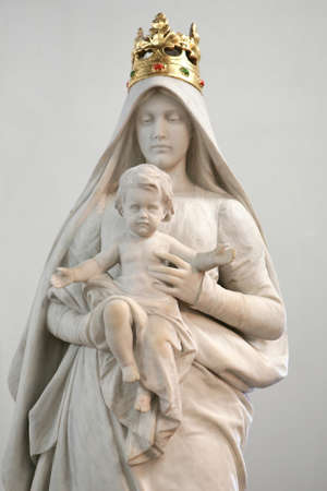 Stone statue of Madonna with Child photo