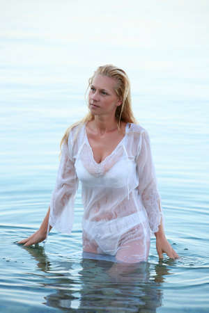 hot breast: Beautiful blond woman in white lingerie and wet shirt