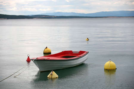 Lonely boat in the water  photo