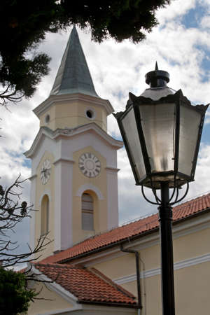 Church tower and street lamp photo