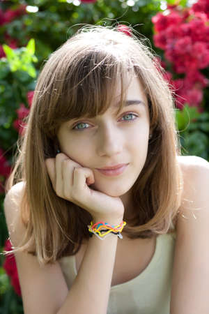 Portrait of a teenage girl in the flower garden photo