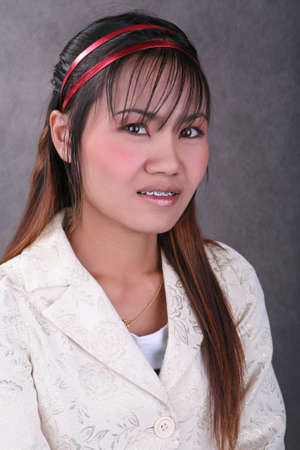 barrettes: Thai girl with braces on her teeth
