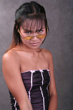 Sexy Thai woman with yellow glasses photo