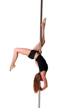 pole dance: Giovane donna esercizio pole dance fitness Archivio Fotografico