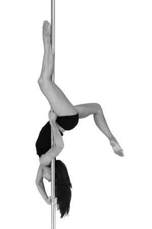 Young woman exercising pole dance fitness, black and white Stock Photo