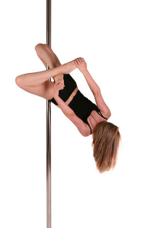 poledance: Young woman exercising pole dance fitness Stock Photo