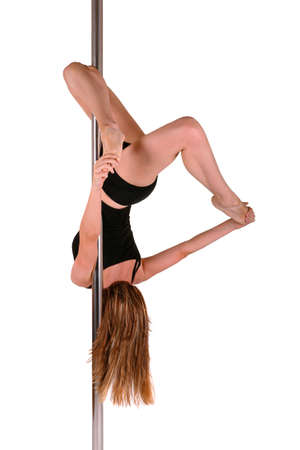 Young woman exercising pole dance fitness Stock Photo - 10360725