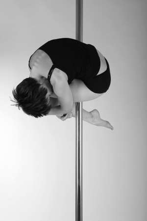Art photo of a woman on the pole, black and white photo
