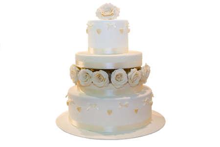 Wedding cake decorated with beige roses, isolated on white photo