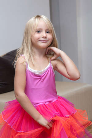 petti: Little girl playing dress up Stock Photo