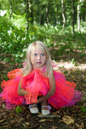 petti: Sad little girl in fairy costume in a forest Stock Photo
