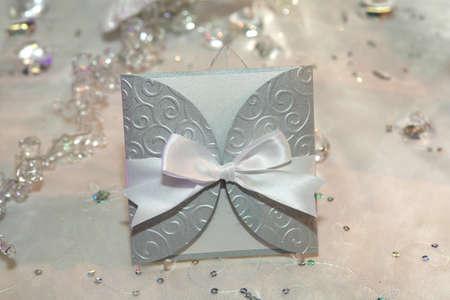 Elegant wedding invitation with a bow photo