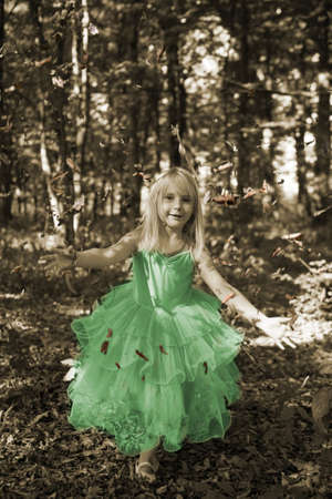 Little girl in fairy costume in the forest photo