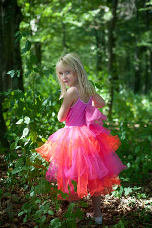 little blonde girl: Little girl in fairy costume in the forest