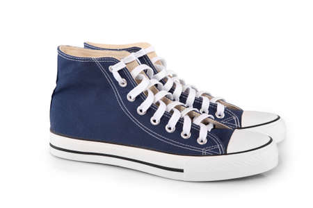 Pair of new blue sneakers with shadow on white background photo