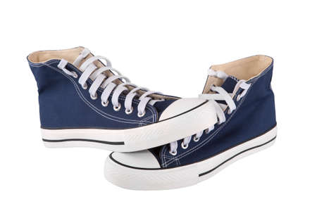 Pair of new blue sneakers on white background photo